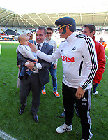 FAO SPORTS PICTURE DESK<br /> Pictured: Manager Brendan Rodgers (R) with his grandson being greeted by a Swansea supporter dressed up as Elvis Presley at the end of the game. Sunday, 13 May 2012<br /> Re: Premier League football, Swansea City FC v Liverpool FC at the Liberty Stadium, south Wales.