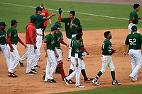 Third baseman Tanner Nishioka (30) of the Greenville Drive, in helmet, is swamped by teammates after getting a walk-off hit to win a game against the Asheville Tourists, 7-6, on Sunday, June 3, 2018, at Fluor Field at the West End in Greenville, South Carolina. (Tom Priddy/Four Seam Images)