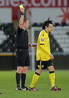 Pictured L-R: Match referee Richard Hulme shows a yellow card to Oscar Borg of Aston Villa Monday 25 April 2016<br /> Re: Play Off semi final, Swansea City AFC U21 v Aston Villa FC U21 at the Liberty Stadium, Swansea, UK