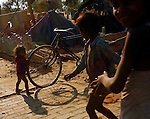 New Delhi,India--12/18/06-12:29:09 AM--.Children play along on the streets, outside of a tent community in Delhi.. .*****************.New Delhi Day 1.. Chris Detrick/Salt Lake Tribune.File #_1CD8324...<br />  Photos from India