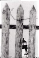 Nantucket lighthouse through wooden fence&#xA;<br />