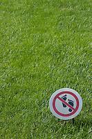 Warning sign on a grassy lawn, Summer Palace, Beijing, China.