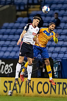 Bolton Wanderers' Ryan Delaney competing with Mansfield Town's Farrend Rawson (right) <br /> <br /> Photographer Andrew Kearns/CameraSport<br /> <br /> The EFL Sky Bet League Two - Bolton Wanderers v Mansfield Town - Tuesday 3rd November 2020 - University of Bolton Stadium - Bolton<br /> <br /> World Copyright © 2020 CameraSport. All rights reserved. 43 Linden Ave. Countesthorpe. Leicester. England. LE8 5PG - Tel: +44 (0) 116 277 4147 - admin@camerasport.com - www.camerasport.com