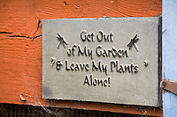 """Get out of My Garden . . . "" whimsical sign in Amy Stewart's garden"
