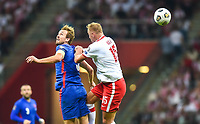 8th September 2021; PGE National Stadium, Warsaw, Poland: FIFA World Cup 2022 Football qualification, Poland versus England;  Harry Kane, with a flicked header past Kamil Glik