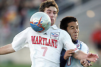Maryland's Stephen King (front) plays the ball away from SMU's Daniel Lopez (behind). The University of Maryland defeated Southern Methodist University 4-1 in the NCAA Semifinal at SAS Stadium in Cary, North Carolina, Friday, December 9, 2005.