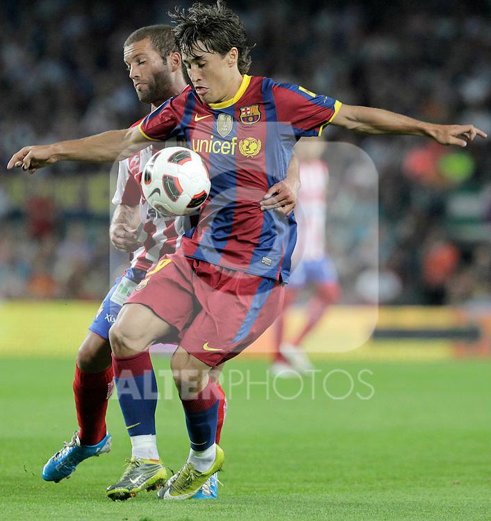 FC Barcelona's Bojan KrKic (r) and Sporting de Gijon's Lora during La Liga match.September 22,2010. (ALTERPHOTOS/Acero)