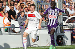 Kevin Gameiro of PSG takes on Mbengue of Toulouse. Toulouse v Paris Saint Germain (1-3), Ligue 1, Stade Municipal, Toulouse, France, 28th August 2011.