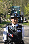 The funeral of the late music manager and punk pioneer Malcolm McLaren in London this afternoon. Policewoman guarding the cemetary..
