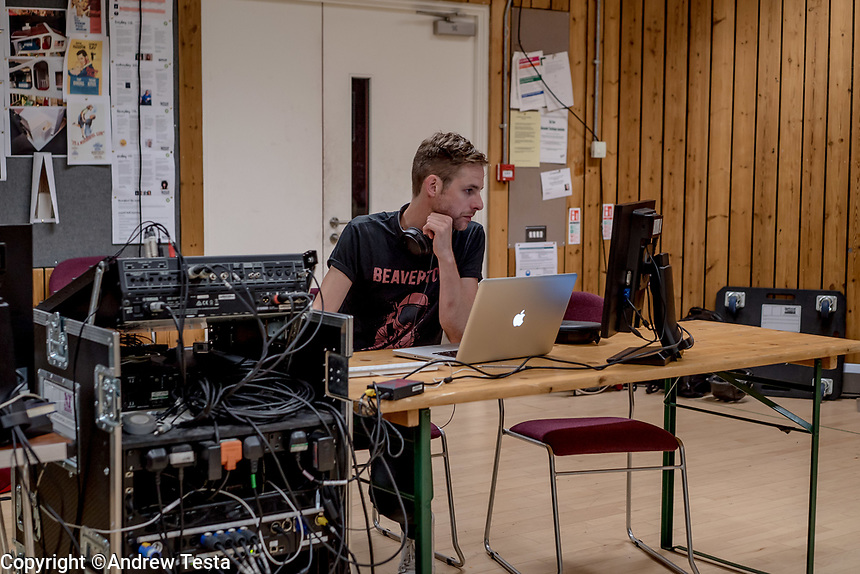 UK. London. 24th May 2018<br /> Tom Gibbons at work in the National Theatre.<br /> Andrew Testa for the New York Times