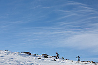 Hikers and clouds on Mt. Bierstadt