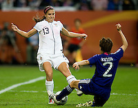 Alex Morgan (13) of the United States fights for the ball with Yukari Kinga (2) of Japan during the final of the FIFA Women's World Cup at FIFA Women's World Cup Stadium in Frankfurt Germany.  Japan won the FIFA Women's World Cup on penalty kicks after tying the United States, 2-2, in extra time.