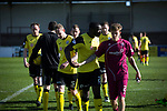 Arbroath 0 Edinburgh City 1, 15/03/2017. Gayfield Park, SPFL League 2. Visiting defender Joe Mbu has words with an opponent as the teams leave the pitch after the final whistle as Arbroath hosted Edinburgh City (in yellow) in an SPFL League 2 fixture. The newly-promoted side from the Capital were looking to secure their place in SPFL League 2 after promotion from the Lowland League the previous season. They won the match 1-0 with an injury time goal watched by 775 spectators to keep them 4 points clear of bottom spot with three further games to play. Photo by Colin McPherson.