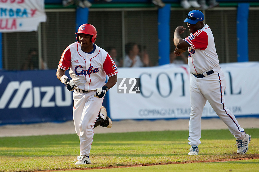 27 September 2009: First base Ariel Borrero of Cuba runs the bases as he hits a two run home run off pitcher Brad Lincoln to tie the score during the 2009 Baseball World Cup gold medal game won 10-5 by Team USA over Cuba, in Nettuno, Italy.