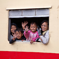 Myanmar, Burma.  Burmese Family Waving at the  Kalaw Train Station.