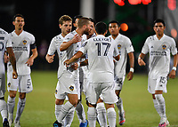 LAKE BUENA VISTA, FL - JULY 18: Sebastian Lletget #17 of LA Galaxy is swarmed by teammates after scoring a goal during a game between Los Angeles Galaxy and Los Angeles FC at ESPN Wide World of Sports on July 18, 2020 in Lake Buena Vista, Florida.