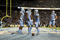 CHAPEL HILL, NC - NOVEMBER 02: Dyami Brown #2 of the University of North Carolina celebrates his first touchdown with teammates Javonte Williams #25, Dazz Newsome #5, and Garrett Walston #84 during a game between University of Virginia and University of North Carolina at Kenan Memorial Stadium on November 02, 2019 in Chapel Hill, North Carolina.