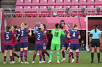 KASHIMA, JAPAN - AUGUST 5: Megan Rapinoe #15 of the United States greets Adrianna Franch #18 before a game between Australia and USWNT at Kashima Soccer Stadium on August 5, 2021 in Kashima, Japan.