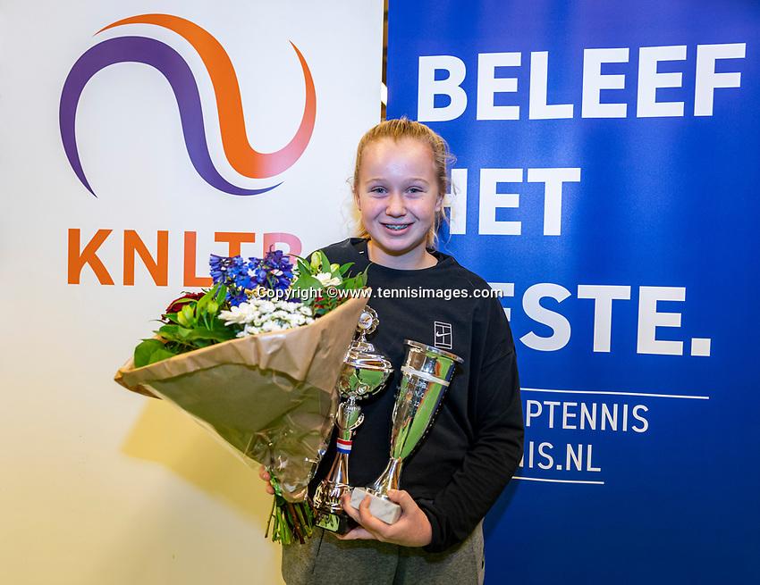 Wateringen, The Netherlands, December 1,  2019, De Rhijenhof , NOJK 12 and16 years, Winner girls 12 years: Britt du Pree (NED) with the trophy<br /> Photo: www.tennisimages.com/Henk Koster