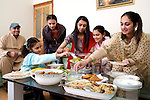 Pix: Shaun Flannery/sf-pictures.com..COPYRIGHT PICTURE>>SHAUN FLANNERY>01302-570814>>07778315553>>..8th December 2008............The Ahmed family celebrate the first day of Eid at their home in Clifton, Rotherham..Pictured are Zulfiqar, Veda, Salimah (red Sari), Alsha, 11, (brown jacket), Aliyah, 9, (pink top) and Isfah, 7, (blue top).