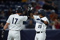 Anthony Seigler (20) of the Hudson Valley Renegades celebrates with teammate Jake Sanford (17) after hitting the first of two home runs on the night against tbe Wilmington Blue Rocks at Dutchess Stadium on July 27, 2021 in Wappingers Falls, New York. (Brian Westerholt/Four Seam Images)