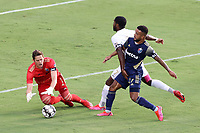 CARY, NC - AUGUST 01: Alex Tambakis #1 grabs the ball as DJ Taylor #27 blocks Brian Wright #7 from getting to it during a game between Birmingham Legion FC and North Carolina FC at Sahlen's Stadium at WakeMed Soccer Park on August 01, 2020 in Cary, North Carolina.