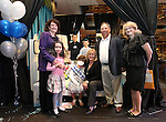 The Gouldsmith family poses with Nevada First Lady Kathleen Sandoval and her daughter Marisa, left, and Cynthia Freeman, right, following the Make-A-Wish Foundation Waffles & Wishes event at the Atlantis Casino Resort, in Reno, Nev., on Tuesday, March 27, 2012. Gabby Gouldsmith, 8, center, who suffers from an auto-immune deficiency disorder, received a bedroom makeover from the organization. .Photo by Cathleen Allison