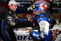 Sept. 18, 2011; Concord, NC, USA: NHRA top fuel dragster driver Antron Brown (right) celebrates with teammate Matt Hagan after winning the O'Reilly Auto Parts Nationals at zMax Dragway. Mandatory Credit: Mark J. Rebilas-