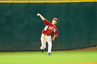Left fielder Joel Ansley #4 of the Houston Cougars throws the ball back to the infield against the Kentucky Wildcats at Minute Maid Park on March 5, 2011 in Houston, Texas.  Photo by Brian Westerholt / Four Seam Images