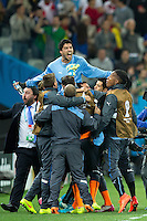 Luis Suarez of Uruguay is lifted up by his team mates in celebration at the end of the match