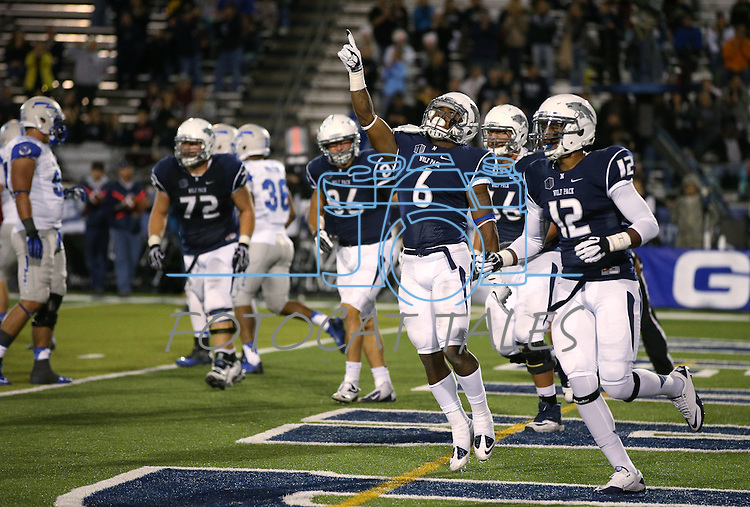 Nevada's Don Jackson, center, celebrates after scoring against Air Force during the second half of an NCAA football game in Reno, Nev., on Saturday, Sept. 28, 2013. <br /> Photo by Cathleen Allison