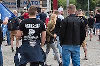 """Bilderberg-Treffen in Dresden.<br /> Verschiedene Rechte, Nazis, Pegida-Teilnehmer und Anhaenger von Verschwoerungstheorien protestierten am Samstag den 11. Juni 2016 in Dresden gegen ein Treffen der sog. """"Bilderberger"""" im Taschenberg Palais. Bei diesem Treffen, das seit 1954 stattfindet, versammeln sich Regierungenangehoerige, Mitglieder wichtiger Think-Tanks und Industrielle verschiedener westlicher Staaten zu einem geheimen Treffen um sich auszutauschen. Ergebnisse dieser Treffen werden nicht veroeffentlicht.<br /> Im Bild: Kundgebung der rechten Gruppe Endgame. Ein Teilnehmer traegt ein T-Shirt mit dem Aufdruck """"Dresdner wurden erschaffen weil Dutschland auch Helden braucht"""" und dazu ein Schaedel der eine Militaermuetze mit einem stilisierten SS-Totenkopf.<br /> 11.6.2016, Dresden<br /> Copyright: Christian-Ditsch.de<br /> [Inhaltsveraendernde Manipulation des Fotos nur nach ausdruecklicher Genehmigung des Fotografen. Vereinbarungen ueber Abtretung von Persoenlichkeitsrechten/Model Release der abgebildeten Person/Personen liegen nicht vor. NO MODEL RELEASE! Nur fuer Redaktionelle Zwecke. Don't publish without copyright Christian-Ditsch.de, Veroeffentlichung nur mit Fotografennennung, sowie gegen Honorar, MwSt. und Beleg. Konto: I N G - D i B a, IBAN DE58500105175400192269, BIC INGDDEFFXXX, Kontakt: post@christian-ditsch.de<br /> Bei der Bearbeitung der Dateiinformationen darf die Urheberkennzeichnung in den EXIF- und  IPTC-Daten nicht entfernt werden, diese sind in digitalen Medien nach §95c UrhG rechtlich geschuetzt. Der Urhebervermerk wird gemaess §13 UrhG verlangt.]"""