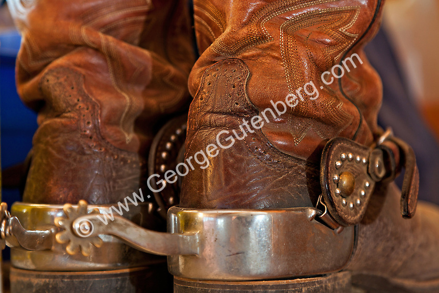 Old brown cowboy boots with silver spurs