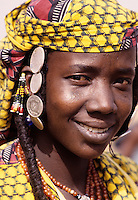 Delaquara, Niger. Young Fulani Woman, with Earrings and Saudi Arabian Coins for Jewelry.  The Saudi coins indicate that someone in the village, probably the lady's husband, has made the pilgrimage to Mecca.