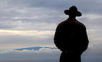 "Hawaiian cowboy, Wayne Tachera, stands at the top of Kahua Ranch, where he works and looks over the beautiful landscape after a hard day's work in North Kohala, Hawaii. Tachera lives with his two daughters, Kamehana, 10, and Nahe, 8, in ""cowboy housing"" which is subsidized by the ranch as part of a cowboy's benefit package. ""We get free housing, free electricity, free water.  It makes up for cowboy pay because cowboy pay is not much at all"","" says Tachera. ""Sometimes we go to the mountain up there and you can see the whole entire ridge and beaches and stuff like that,"" says Tachera's older daughter, Kamehana, 10."