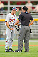 Danville Braves manager Jonathan Schuerholz (2) argues a call with home plate umpire Drew Freed during the game against the Burlington Royals at Burlington Athletic Park on July 18, 2012 in Burlington, North Carolina.  The Royals defeated the Braves 4-3 in 11 innings.  (Brian Westerholt/Four Seam Images)