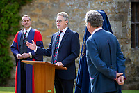 BNPS.co.uk (01202) 558833. <br /> Pic: CorinMesser/BNPS<br /> <br /> Pictured: Turing's nephew and fellow Sherborne School alumni, author Sir John Dermot Turing speaks at the event. <br /> <br /> A magnificent bronze bust of Enigma codebreaker Alan Turing has today gone on display at his former school.<br /> <br /> The bust, which is just over life size, stands on a plinth at Sherborne School in Dorset, where the genius mathematician and father of computer science was a pupil from 1926 to 1931.<br /> <br /> It was unveiled by Turing's nephew and fellow Sherborne School alumni, author Sir John Dermot Turing.<br /> <br /> During the Second World War Turing worked for the Government Code and Cypher School (GC&CS) at Bletchley Park, Bucks, Britain's code-breaking centre. He played a pivotal role in cracking the German Enigma code that enabled the Allies to defeat the Nazis in many crucial battles.<br /> <br /> The bust has been fashioned by acclaimed sculptor David Williams-Ellis, who has previously commemorated the D-Day landings in sculpture for the Normandy Memorial Trust.