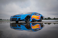 Sep 1, 2019; Clermont, IN, USA; The car of NHRA pro mod driver Alex Laughlin reflects in a rain puddle during a portrait during qualifying for the US Nationals at Lucas Oil Raceway. Mandatory Credit: Mark J. Rebilas-USA TODAY Sports