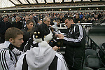 Newcastle United 2 Watford 1, 16/12/2006. St James Park, Premier League. Newcastle United take on Watford (yellow shirts) in a Premiership match at St. James' Park, Newcastle. Both teams were struggling near the bottom of the table with the newly-promoted visitors occupying one of the three relegation at the time of the match. Newcastle won by 2 goals to 1, both being scored by Obafemi Martins. Hameur Bouazza had equalised before United's late winner. Photo shows the interior of St. James Park with United fans having autographs signed by injured reserve goalkeeper Steve Harper before the start of the game. Photo by Colin McPherson.