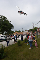 """IN FOR A LANDING<br />People watch an Air Evac Lifeteam helicopter land on Saturday June 5 2021 during a """"Touch a Truck"""" event at Centerton City Hall. Northwest Health, along with Centerton police and fire departments hosted the hands-on event. Kids got to sit inside a fire truck, police car and ambulance at the event. Go to nwaonline.com/210606Daily/ to see more photos. <br />(NWA Democrat-Gazette/Flip Putthoff)"""