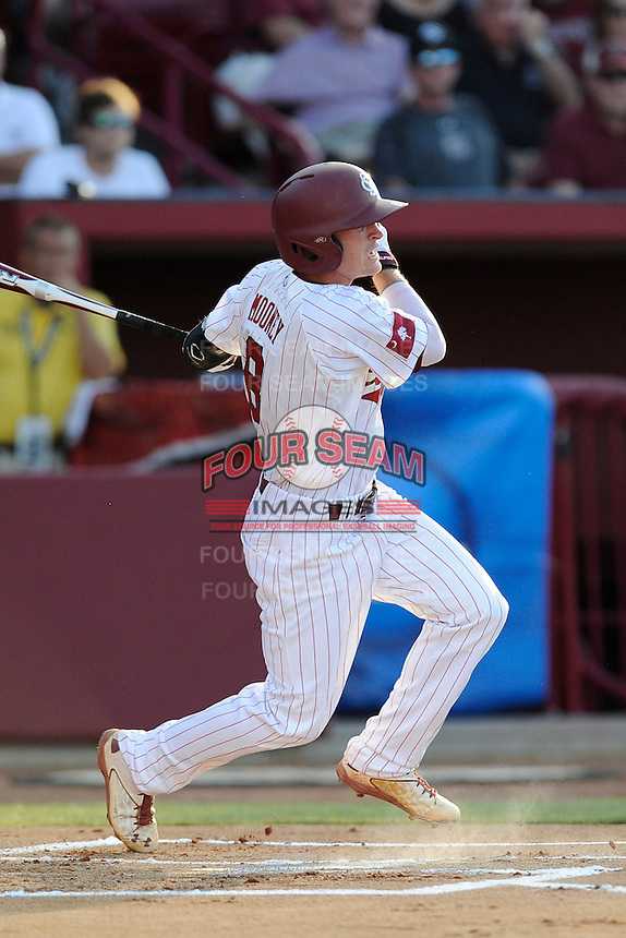 Shortstop Marcus Mooney (8) of the South Carolina Gamecocks bats in an NCAA Division I Baseball Regional Tournament game against the Maryland Terrapins on Sunday, June 1, 2014, at Carolina Stadium in Columbia, South Carolina. Maryland won, 10-1, to win the tournament. (Tom Priddy/Four Seam Images)