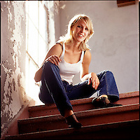 Woman on top of steps looking at camera