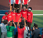 Venus Williams (right with visor) joins the Washington Kastles as they play at the World Team Tennis match between the Washington Kastles and the Boston Lobsters on July 16, 2012 in Washington, DC.