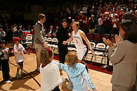 23 February 2006: Kids lineup to clap hands with Krista Rappahahn during Stanford's 100-69 win over the Washington Huskies at Maples Pavilion in Stanford, CA.