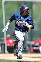 Atlanta Braves catcher Bryan De La Rosa (24) during a minor league spring training game against the Washington Nationals on March 26, 2014 at Wide World of Sports in Orlando, Florida.  (Mike Janes/Four Seam Images)