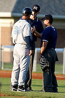 August 12, 2009:  Manager Jeff Garber of the Vermont Lake Monsters argues a call with umpires Joe Muenzer (back) and Chris Nguyen during a game at Dwyer Stadium in Batavia, NY.  The Lake Monsters are the Short-Season Class-A affiliate of the Washington Nationals.  Photo By Mike Janes/Four Seam Images