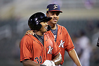 Bryce Bush (30) of the Kannapolis Intimidators is congratulated by teammate Devon Perez (39) after his 2-run single in the bottom of the ninth inning defeated the Rome Braves at Kannapolis Intimidators Stadium on July 2, 2019 in Kannapolis, North Carolina.  The Intimidators walked-off the Braves 5-4. (Brian Westerholt/Four Seam Images)