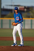 AZL Cubs 2 starting pitcher Yovanny Cruz (58) prepares to deliver a pitch during an Arizona League game against the AZL Reds at Sloan Park on June 18, 2018 in Mesa, Arizona. AZL Cubs 2 defeated the AZL Reds 4-3. (Zachary Lucy/Four Seam Images)