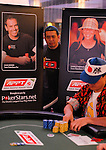 Chuck Chua peers in on the action amongst Pokerstars Team Pro posters.