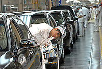 Workers make the final checks and adjustments at the end of the production line of the Honda Accord at the new Guangzhou Honda Automobile Co. Ltd. factory. The plant built at a cost of 140 million US$ is one of the most advanced car plants in the world. It has a state of the art production line as well as the world's first total water re-cycling sytem..